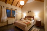 These Alpine-style brick and wood cottages in Patagonia offer one bedroom in a 786 sq ft single-level plan. | www.facebook.com/SmallHouseBliss