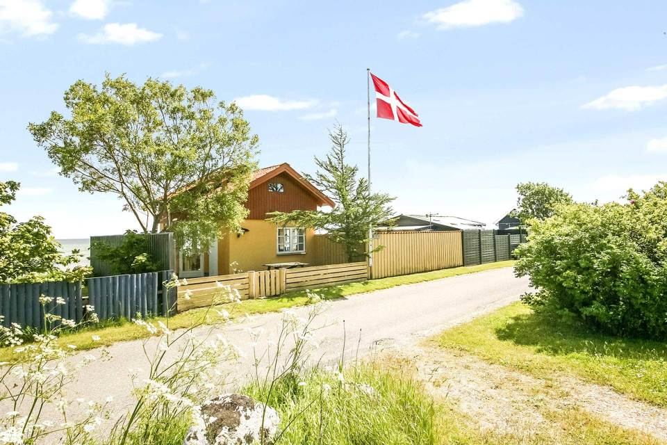 This tiny beachfront cottage in Denmark has 172 sq ft on the ground floor plus a sleeping loft. | www.facebook.com/SmallHouseBliss