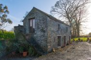 Crows' Hermitage is an old stone barn in the Irish countryside that has been converted into a sumptuous holiday cottage. | www.facebook.com/SmallHouseBliss
