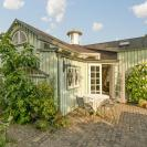 This fanciful allotment hut in Denmark has a tiny bedroom, a sleeping alcove and a sleeping loft in its 645 sq ft. | www.facebook.com/SmallHouseBliss