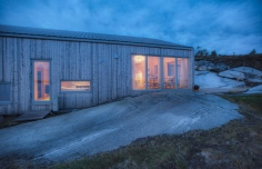 This modern wood cabin sits on the rugged coast of Norway. It has a bedroom, a sleeping nook and a loft, all in a footprint of just 645 sq ft. | www.facebook.com/SmallHouseBliss