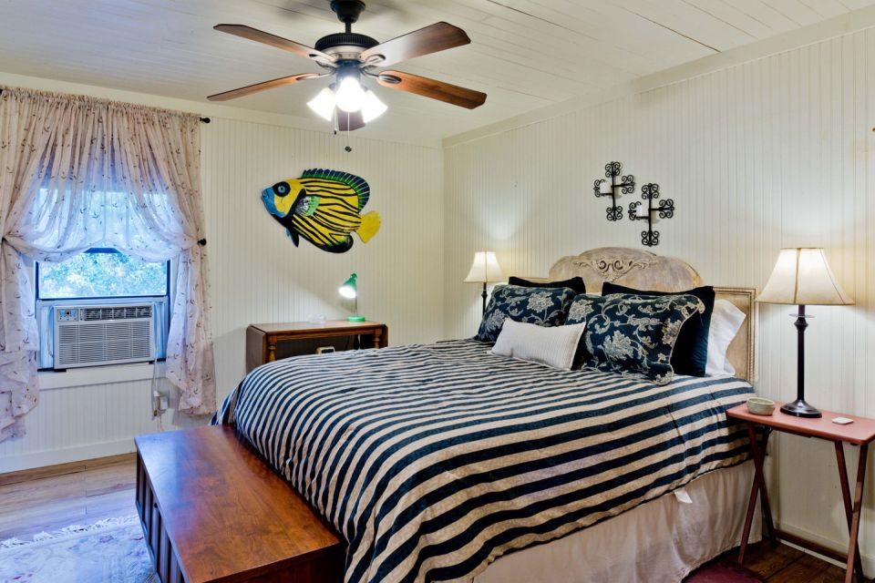 "The ""Tale Inn"", a Southern-style one-bedroom cottage with pleasing proportions, welcoming front porch and authentic architectural details. 