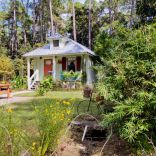 """The """"Tale Inn"""", a Southern-style one-bedroom cottage with pleasing proportions, welcoming front porch and authentic architectural details. 